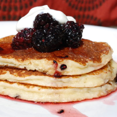 Almond Pancakes with Blackberry Honey Syrup and Greek Yogurt Sweet Cream