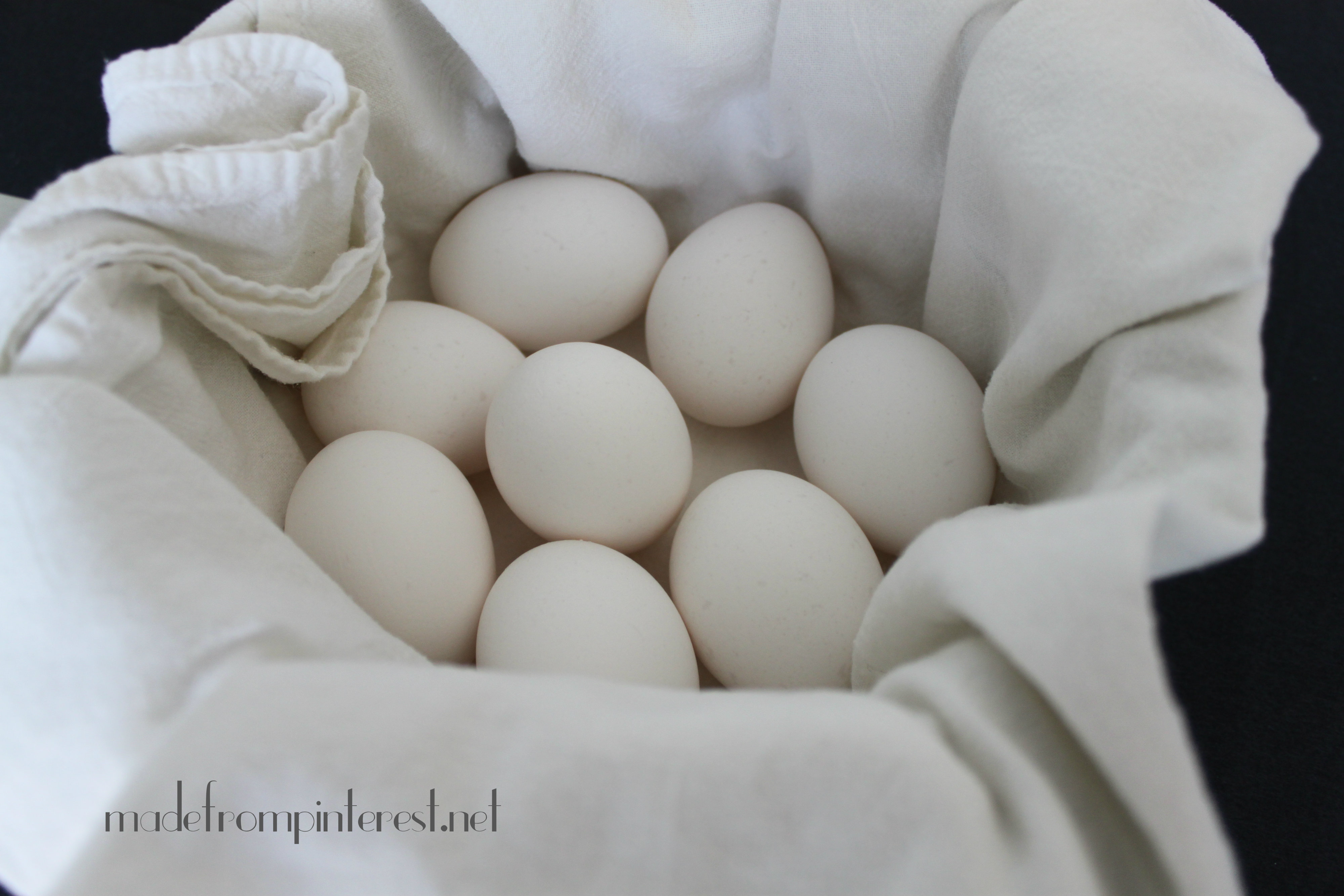 Place a clean white cotton kitchen towel in pot to cushion eggs so they won't crack @madefrompinterest.net