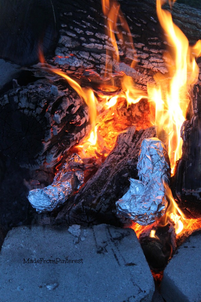 Campfire Banana Boats mummified in the fire. These were a hit at our Memorial Day gathering with friends at the lake. Tutorial from the sisters at MadeFromPinterest