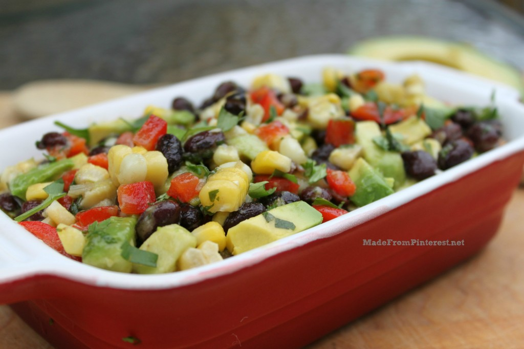 If you don't want to bring leftovers home from the pot luck, this is the recipe you want to make! Corn, Black Bean, Avocado,Cilantro Salsa recipe at the site with the crazy sisters of MadeFromPinterest.net