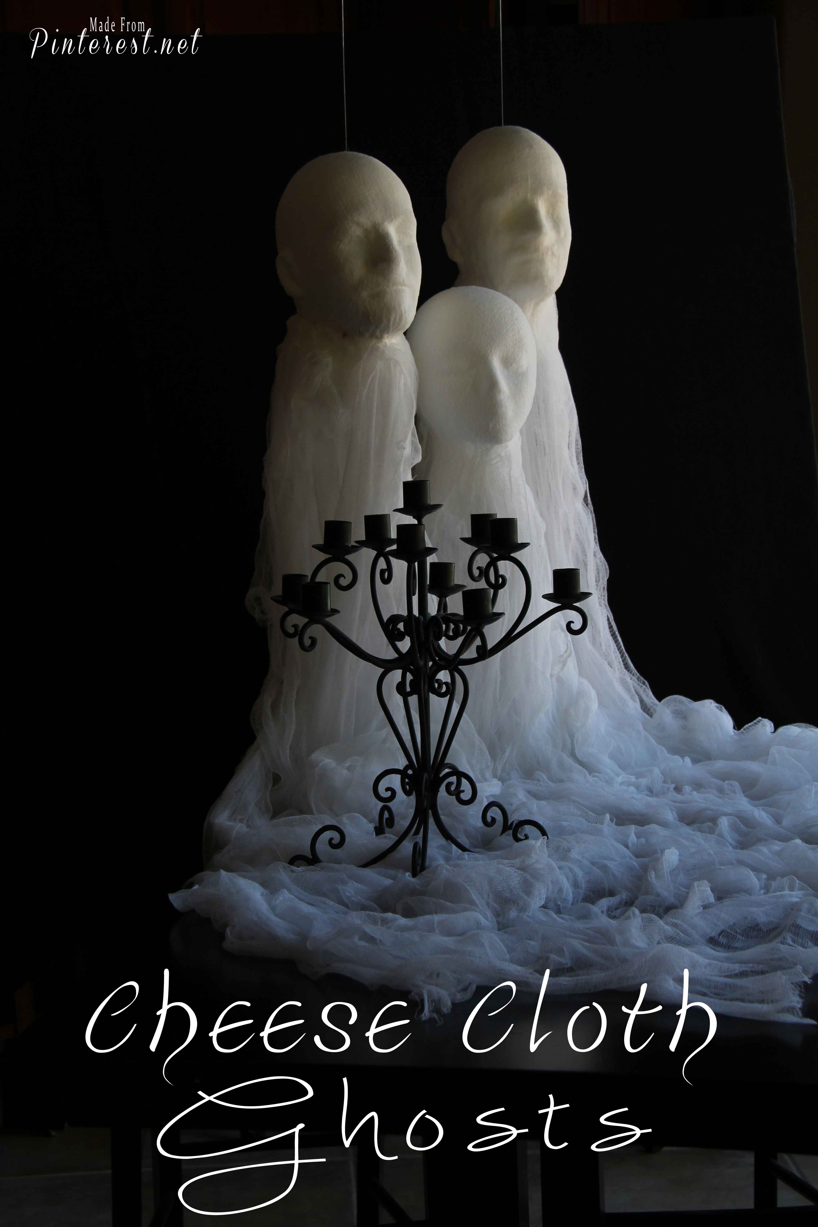 Cheese Cloth Ghosts - Make these creepy looking ghosts with cheese cloth, glue and wig heads. Awesome decorations for Halloween! #Halloween #Decorations #Ghosts #Spirits