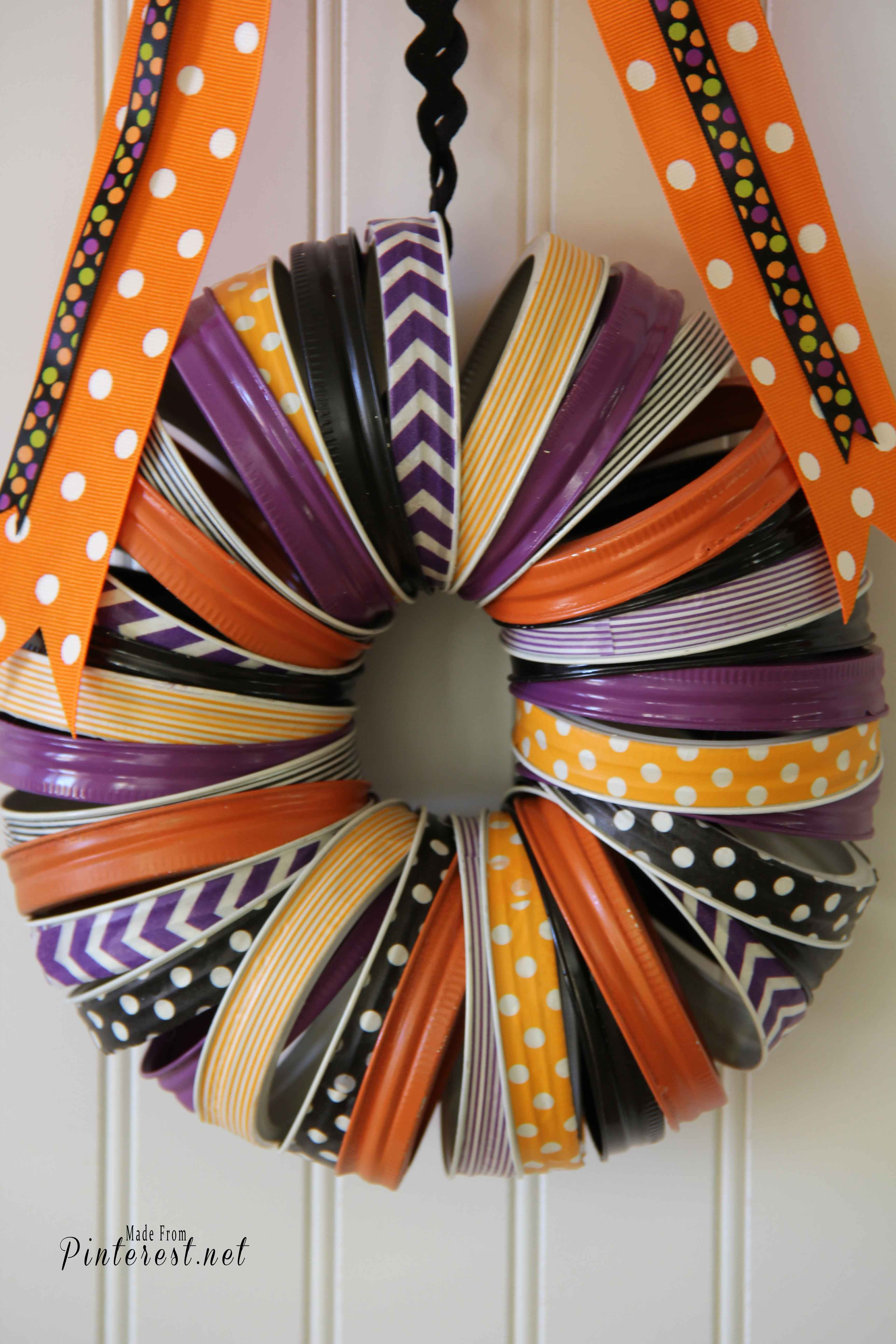 Diy halloween wreath - Halloween Wreath Make This Darling Halloween Wreath With Mason Jar Rings And Washi Tape