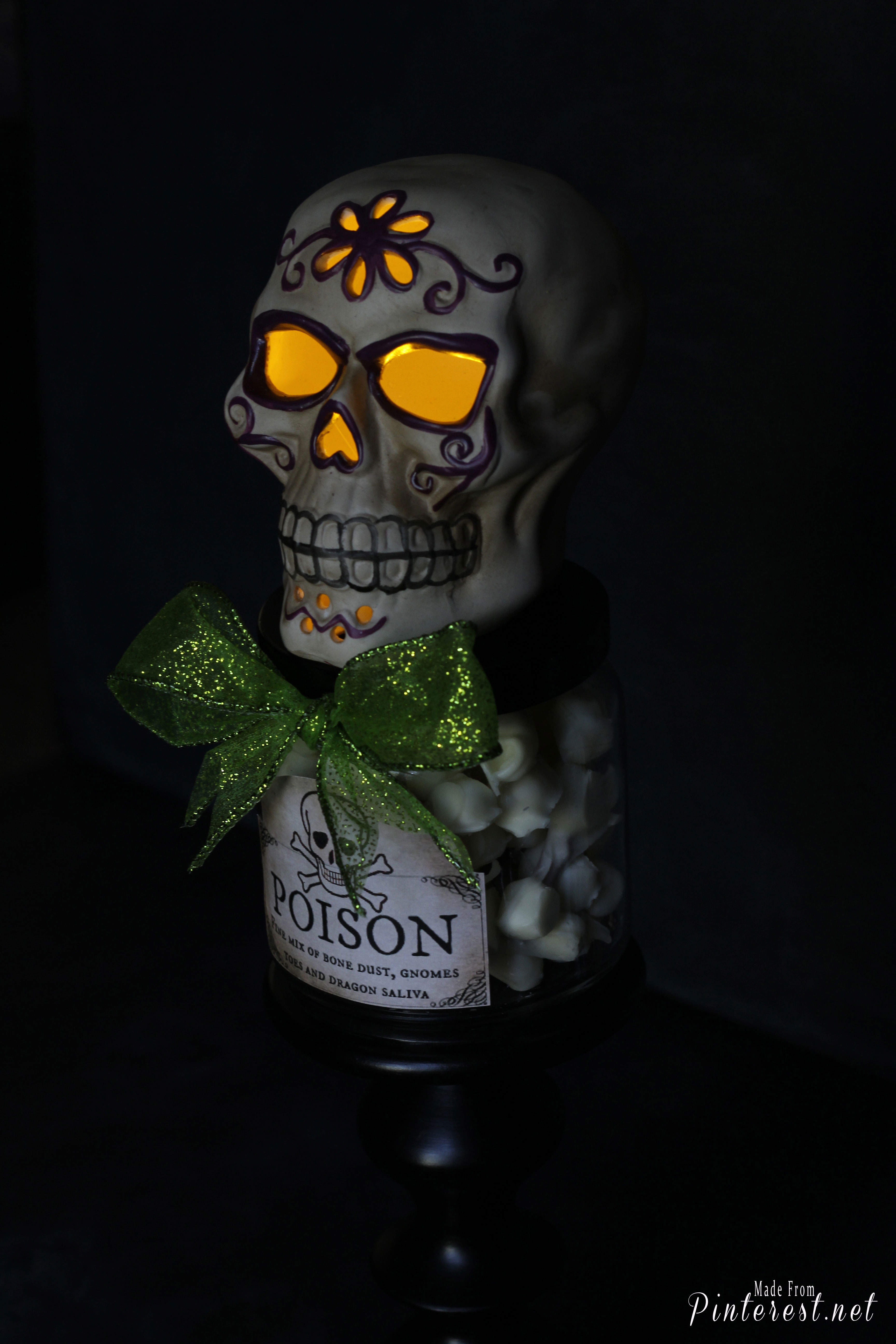 Upcycled Candle Jar - Make a fun, creepy Halloween decoration with your used candle jars! #Halloween #Halloween Decoration