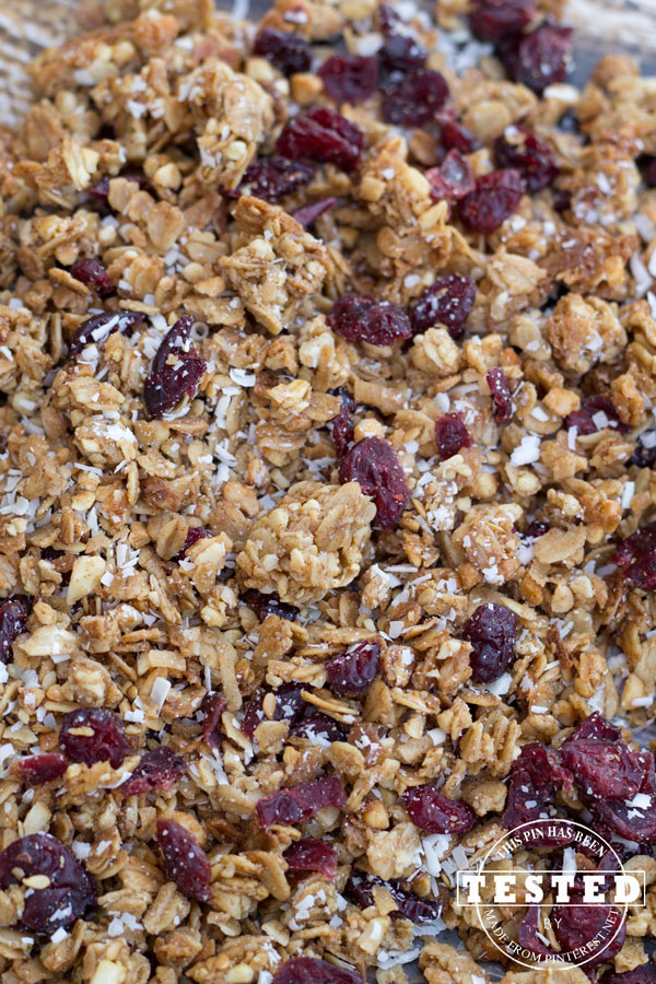 White Chocolate & Craisen Granola - This will ruin any other granola experience for you, it's that good! The sweet and tangy flavors combine to make this the best granola ever! Watching your sugar intake? No worries, the regular recipe has also been converted to a sugar free version that tastes just as good as the original. Everyone can have their granola and eat it too! #Recipe #Granola Recipe #Craisen #Chocolate