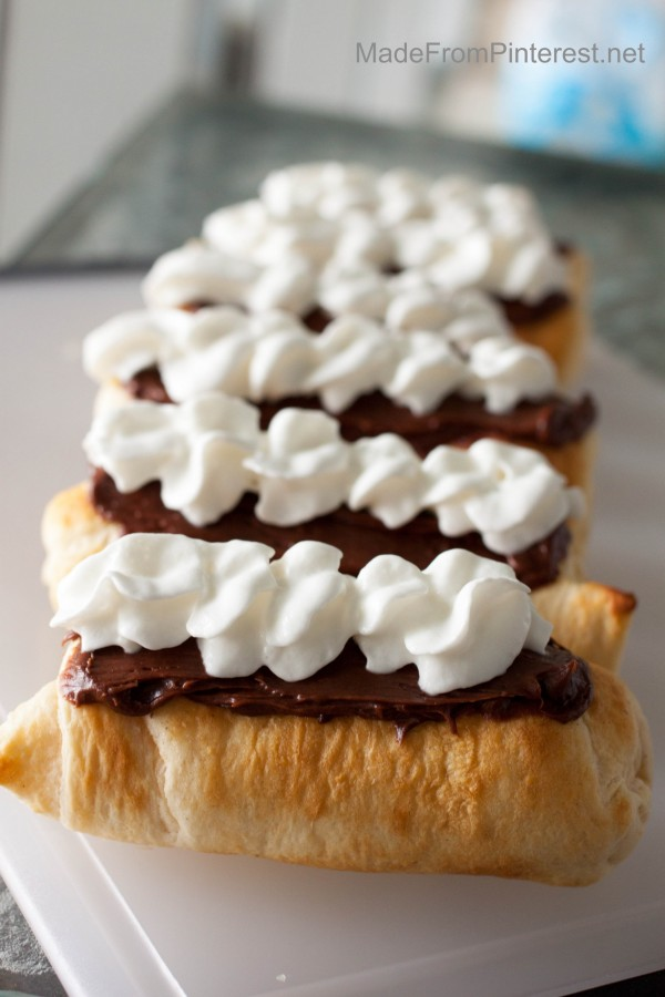 Campfire Eclairs will be a new tradition. A campfire treat that tastes as pretty as it looks. So clever and easy!