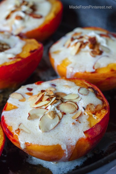 Baked Peaches and Cream delicious with toasted almonds, marscapone cream sauce and a sprinkle of cinnamon sugar