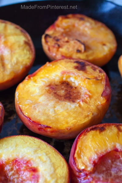Baked Peaches and Cream  - baked to golden brown ready to be topped with marscapone cream sauce and almonds.