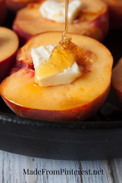 Baked Peaches and Cream - Butter and honey drizzled peaches bake up to perfection and are later topped with cream, cinnamon sugar and almonds!