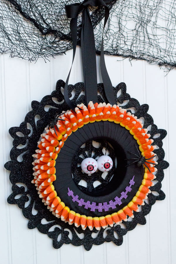 I love making Halloween decorations! This monster candy corn wreath is fun, easy and inexpensive with supplies from Dollar Trees Value Seekers Club. #DTVSC #AD