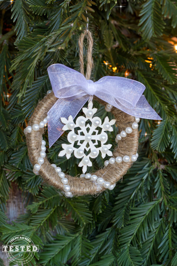 Mason Jar Ring Ornament - Making this rustic Mason Jar ring ornament is a quick and easy Christmas project. They look lovely on a tree, or used to adorn wrapped gifts!