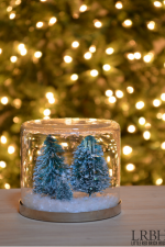 Christmas Snow Globes - Make a charming Christmas snow globe in no time with a few craft supplies. They will bring the magic of Christmas wherever you display them!