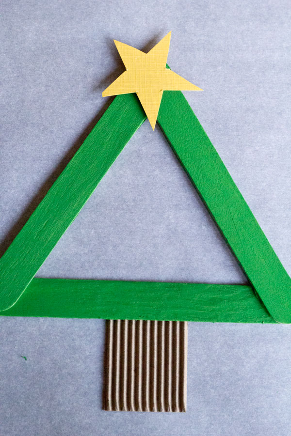 DIY Kids Christmas Tree Ornament You are going to LOVE creating these DIY Kids Christmas Tree Ornaments! This is a quick and easy craft for you and your kids, you can make 7-10 trees in under an hour. Make your tree unique by using different paint colors and embellishments, the possibilities are endless. They cost pennies to make and will look darling on any Christmas tree!