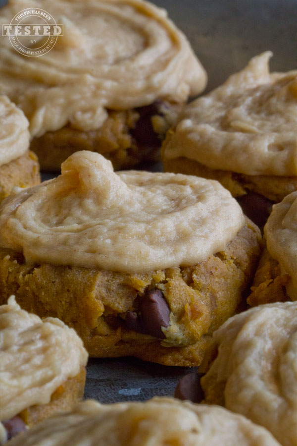 Peanut Butter Pumpkin Cookies - Peanut butter, pumpkin and chocolate chips come together in a moist, rich, chewy cookie to good to resist. Topped with creamy peanut butter, cream cheese frosting for the ultimate cookie experience!