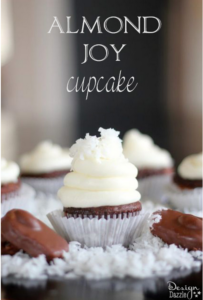 Almond Joy Cupcake - These lovely Almond Joy Cupcakes taste as good as they look! The chocolate ganache in the center of the cupcake is to DIE for!