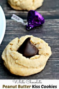 White Chocolate Peanut Butter Kiss Cookies| Soft white chocolate peanut butter cookies complimented with a dark chocolate kiss.
