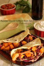 Roasted Squash & Black Bean Tacos - These tacos are full of fresh ingredients like earthy butternut squash, black beans and a bright, spicy, garden slaw to drive up the heat.