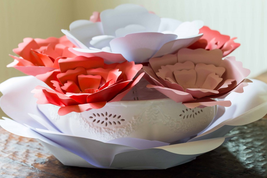Easy paper flowers make a beautiful centerpiece. These would be  great for garden parties, little girls rooms, and photo backdrops.