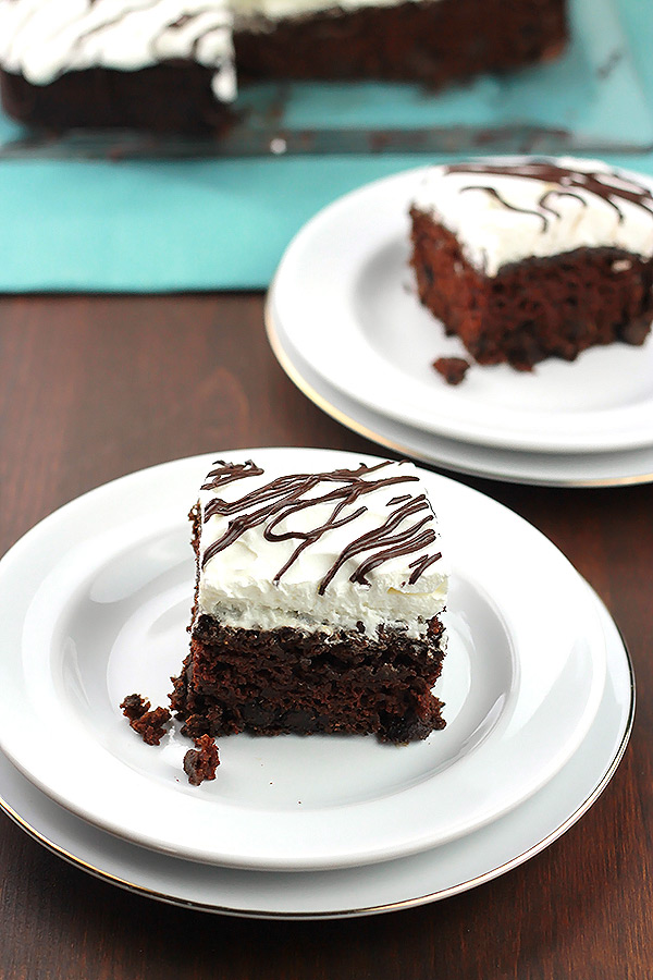 Coconut Cream Chocolate Cake - This cake is rich, moist and full of flavor. The chocolate cake is frosted in a light and fluffy creamy coconut milk frosting making it irresistible!