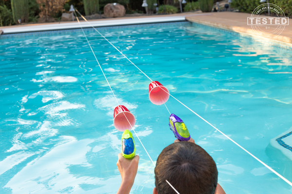 Beat the heat and avoid summer boredom with a few games of Squirt Gun Races. With a few simple items you probably already have around the house. A squirt gun obstacle race course can be created that will keep your kids and their friends entertained for hours. Watching your kids play through the course will keep you entertained as well! I love finding ideas like this that get my kids outdoors doing something active, away from TV shows, video games, and movies.