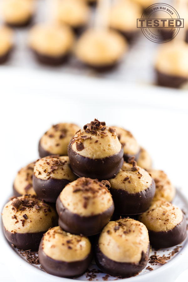 Krispie Buckeye Candy Recipe. These are quick and so easy to make. The perfect combination of peanut butter dipped in chocolate, with a surprise ingredient making them the best Buckeye Candy you will ever eat!