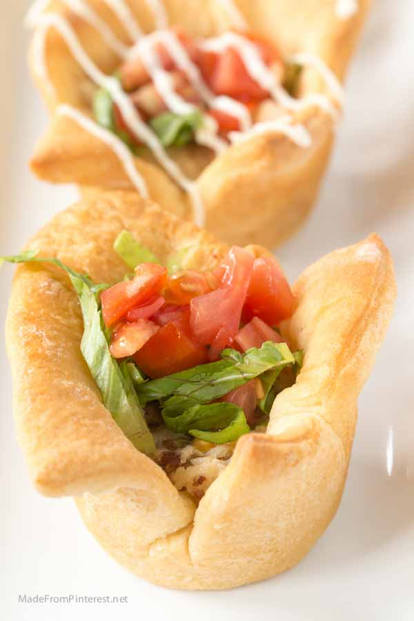 Don't pull out another tired frozen dinner. You can make these in the time it takes to get a pizza delivered! And you can make your own frozen dinner with these crescent roll cups filled with swiss cheese, chicken and bacon filling and topped with lettuce and tomato. These Chicken Cordon Bleu BLT Cups are AMAZING! A little drizzle of homemade dressing is the perfect finish.