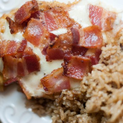 An easy recipe for moist chicken topped with cheese and bacon. Oh yes, I said bacon.