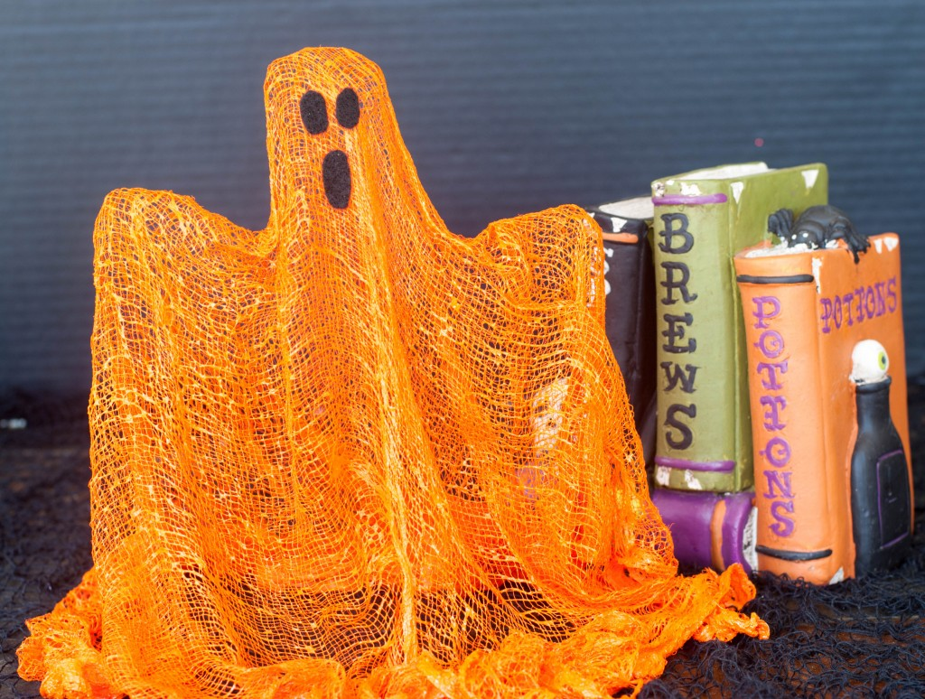 These cheesecloth ghosts add a pop of color to the traditional white ghost.