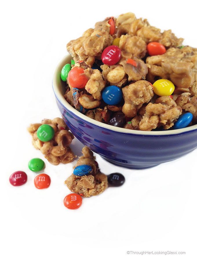 Peanut Butter M&M Protein Clusters with peanuts, peanut butter and high protein Cheerios. No added sugar. Fast and easy, healthier snack.