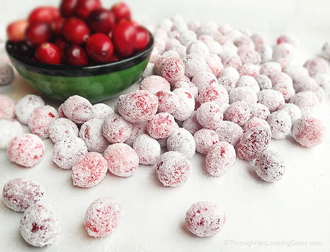 Festive Sugared Cranberries. Bursting w/flavor that pops in your mouth. Sweet & tart. Tangy & addictive. Perfect garnish, snack, stocking stuffer and gift.