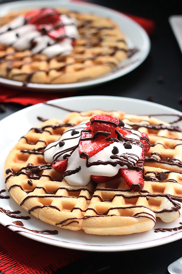 Shortcut to deliciousness, quick and easy Strawberry Waffle Cakes, layered with fresh strawberries, coconut cream and chocolate. A new way to use your box cake mix.