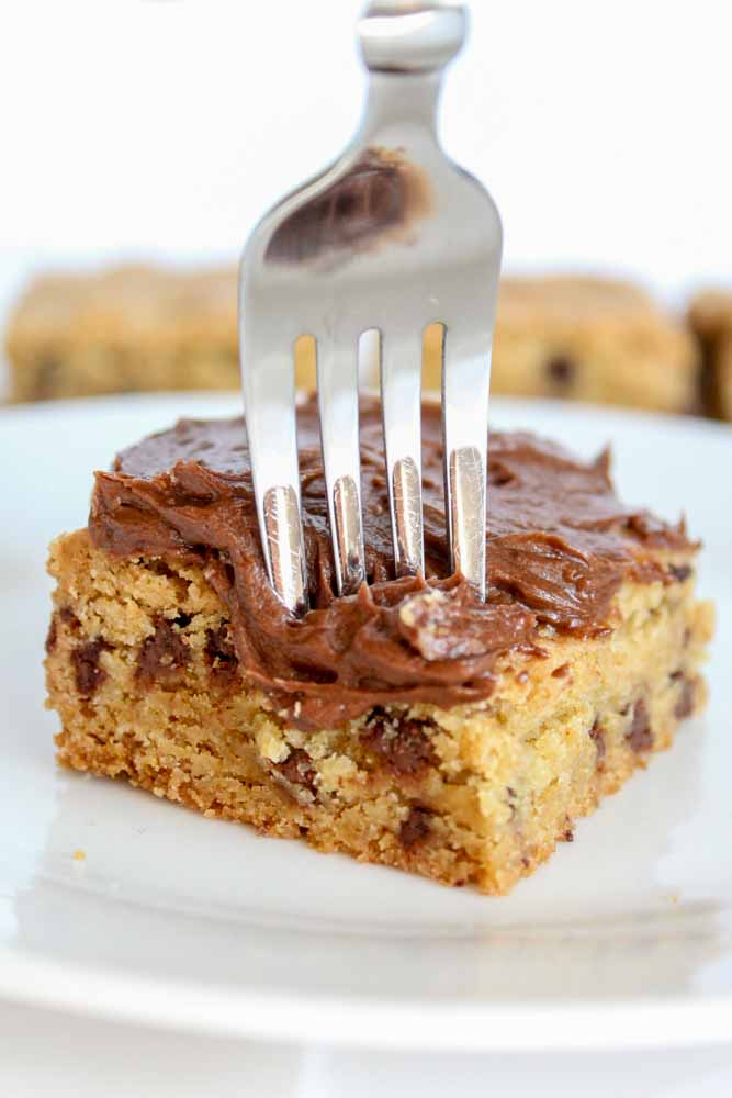 Soft and chewy Chocolate Chip Cookie Bars made with brown butter and topped with the best 5-minute chocolate buttercream frosting.