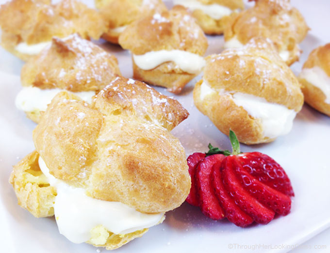 Lemon Filled Cream Puffs are a light and puffy dessert, perfect for spring baby or wedding showers, even Easter. Beautiful presentation and so easy to make!