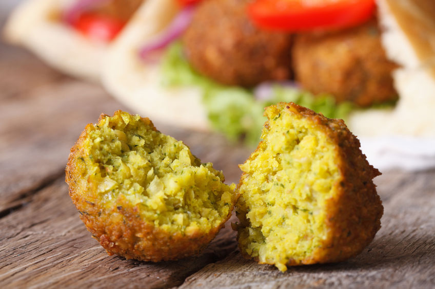 falafel-macro-on-a-wooden-table-with-pita-bread