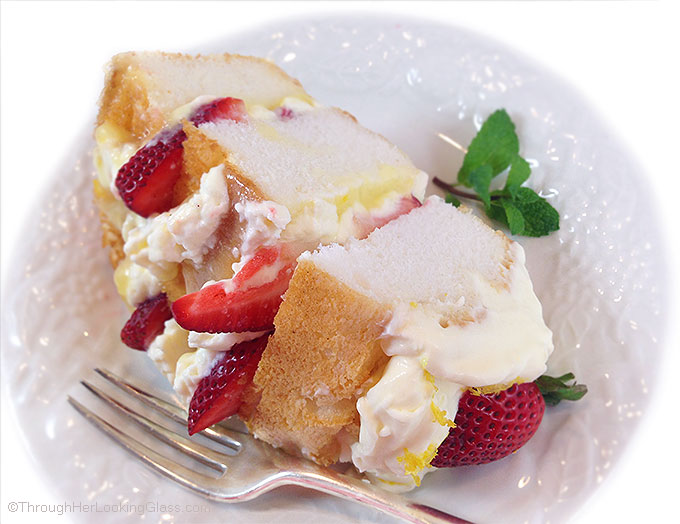 Lemon Cream Strawberry Angel Food Cake: angel food cake layered with lemon curd, lemon cream, and fresh strawberries for a light and airy dessert.