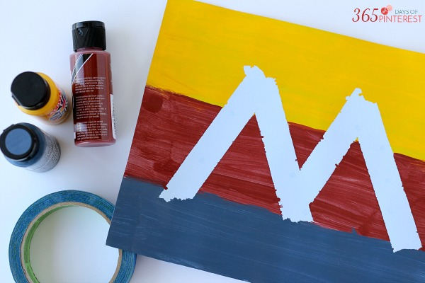 Tape Resist Letter Art is an easy DIY craft that makes a great personalized gift. It is perfect for Mother's Day!