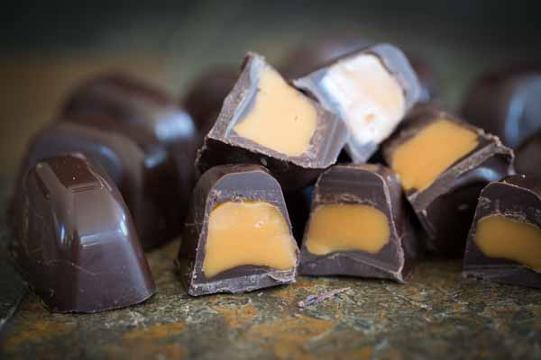 These Ice Cube Tray Chocolates are SO fun and easy to make! Within minutes you can have a filled chocolate candy to give as gifts or to keep for yourself. I made a ton in one afternoon and will definitely be making more.