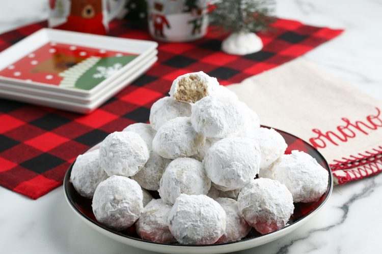 Snowball Cookies Recipe. It's not Christmas around our house until these cookies get baked. With a great nutty flavor sprinkled with powdered sugar, they will soon become a family favorite for you too.