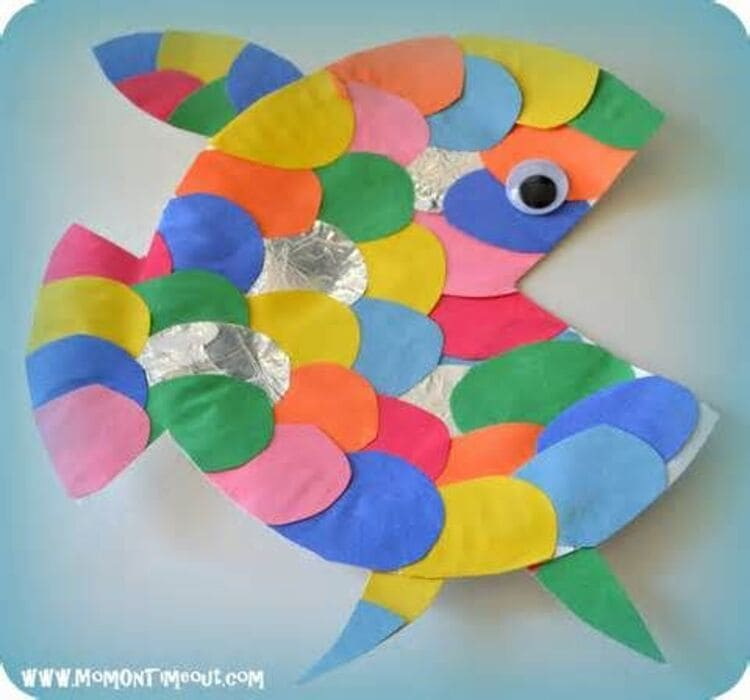 paper plate craft rainbow fish with yellow, green, pink, red, blue scales, on a white background