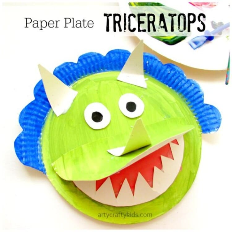 paper plate craft green triceratops with open mouth smiling, on a white background