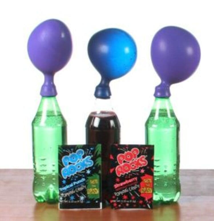 science project pop rocks expander, three bottles with balloons on them
