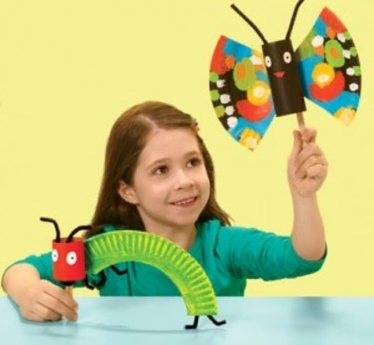 paper plate craft kid holding colorful paper plate butterfly and a caterpillar