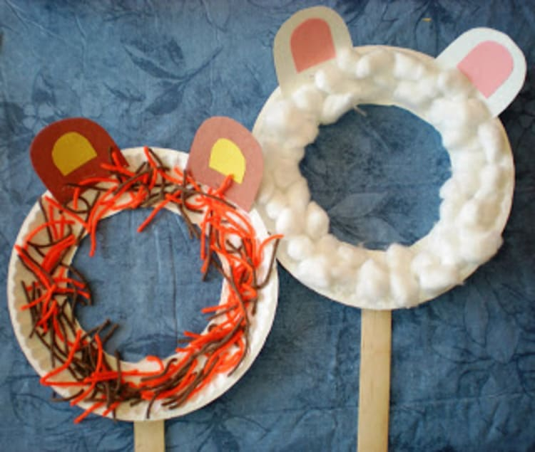 paper plate craft lion and lamb mask on a blue background
