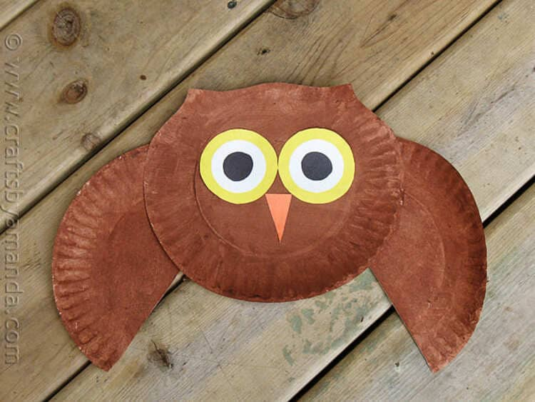 paper plate owl craft on a wooden background
