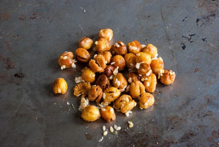 Roasted chickpeas recipe chickpeas with sesame on black background