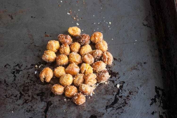 Roasted chickpeas recipe, chickpeas with seasoning on a black background