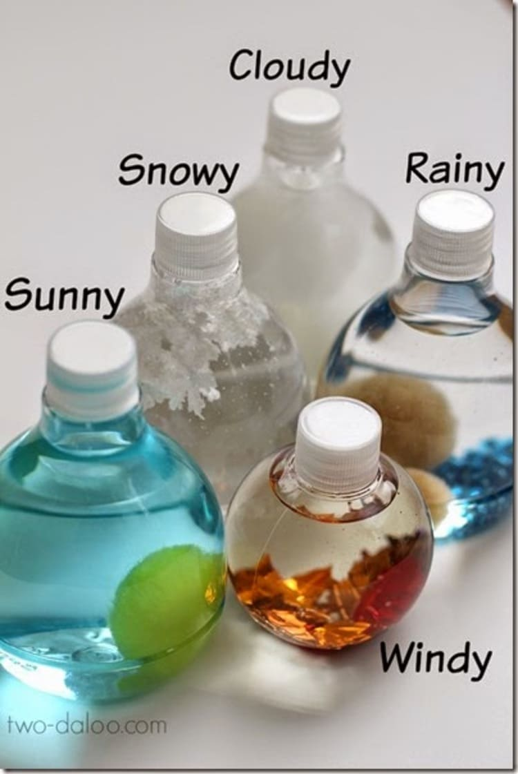 five bottles themed according to different weathers to make sensory weather bottles