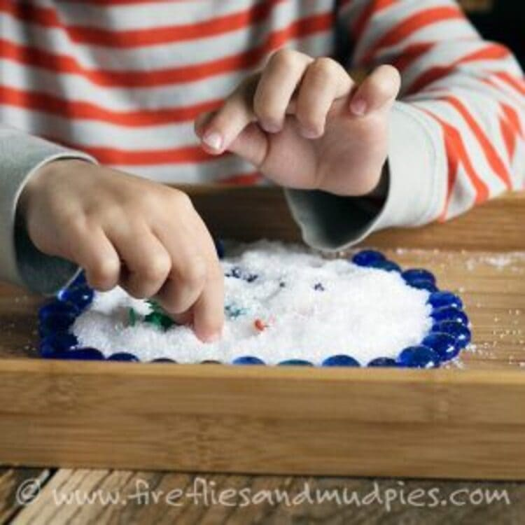 Epsom salts sensory play - A child playing with Epsom salts on a plate