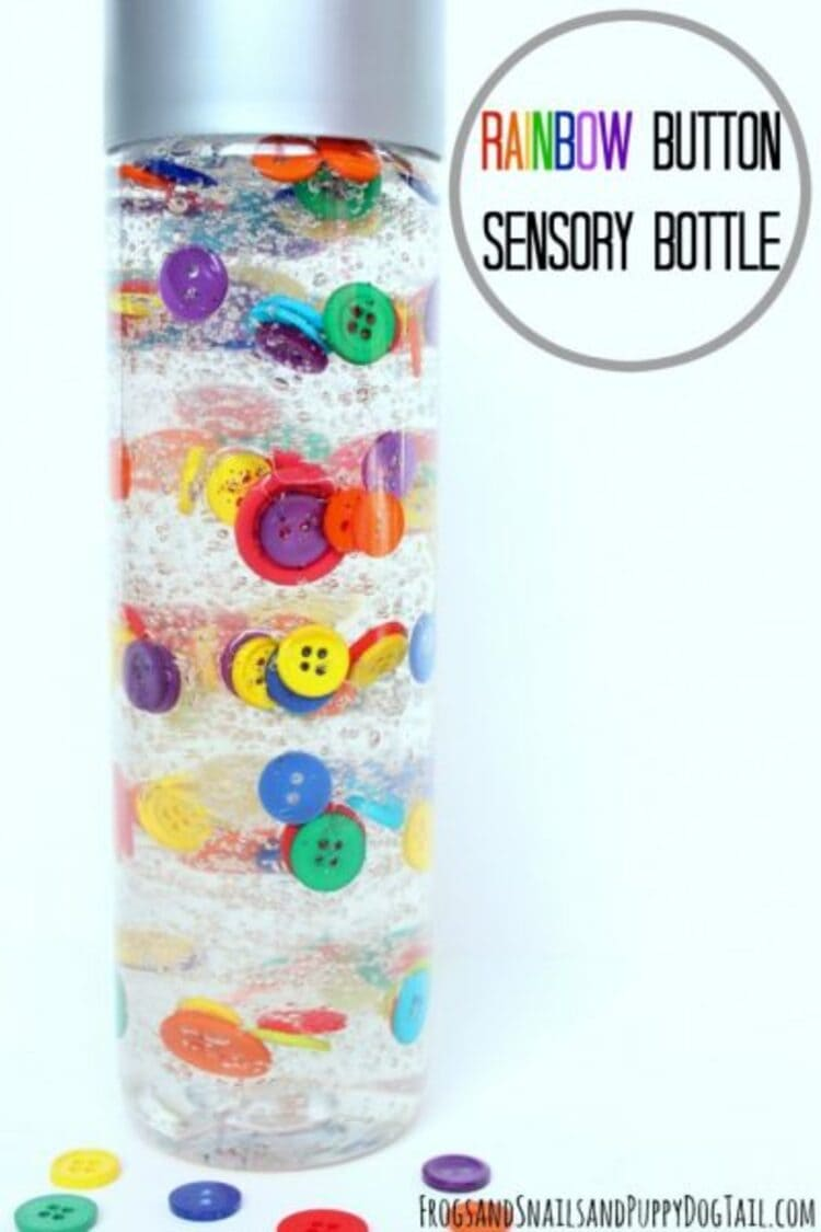 A bottle filled with rainbow colored buttons to stimulate senses
