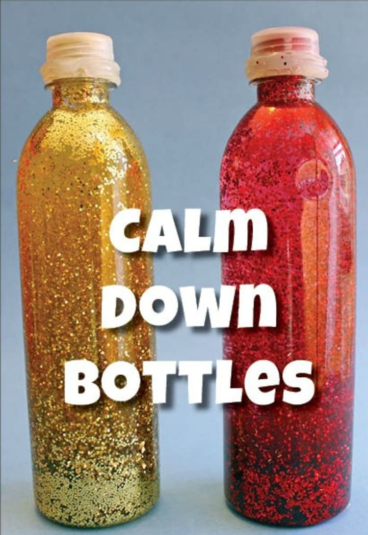 Two bottles filled with glitter placed on a table
