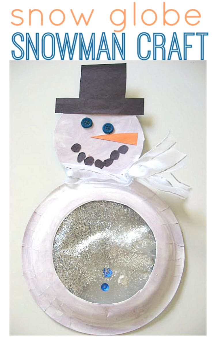 snow globe snowman craft with glitter and a white ribbon, wearing black hat on a white background